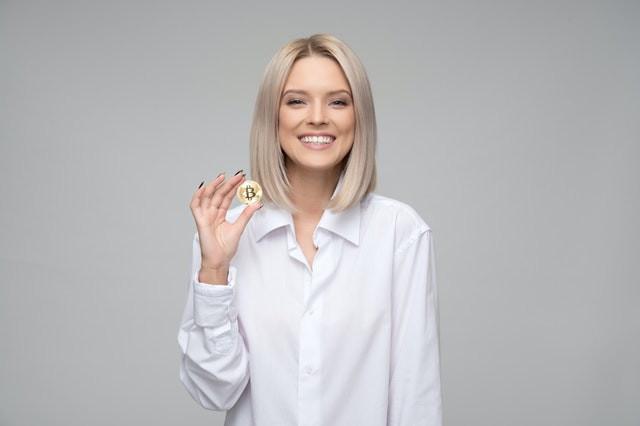 women-wearing-white-long-sleeved-collared-shirt-holding-1037915